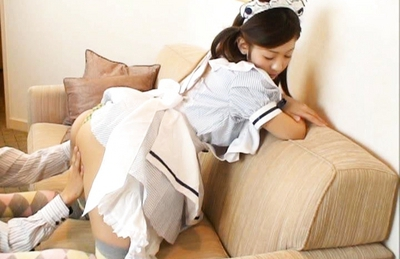Japanese AV model plays maid and fondles her pussy