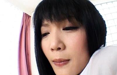 Yuri Hiyoshi Pretty Asian schoolgirl gives a blowjob