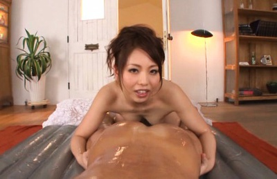 Oiled Yuki Kami likes to ride cock whenever she can