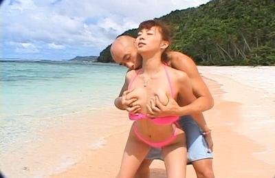 Honoka Asian model enjoys getting a fucking on the beach