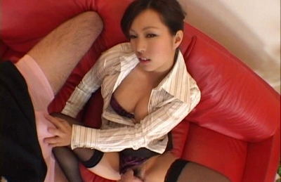 Japanese AV model fondles cock with her feet and sucks it off
